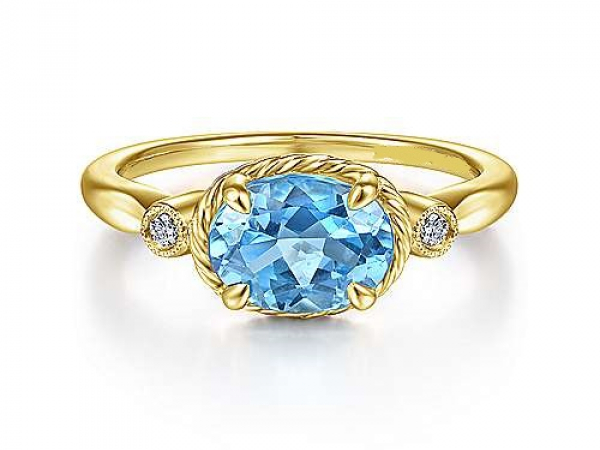 14kt YG Ring with 1.57ct Oval Swiss Blue Topaz by The Ring
